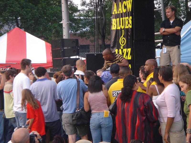 Dave Chappelle chats with his neighbors and fans at the AACW Blues Fest.
