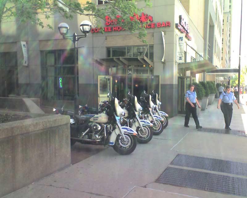 4 Dayton Police Motorcycles parked on the sidewalk outside Boston Stoker
