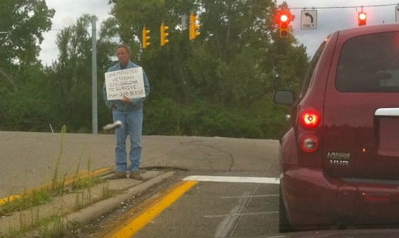 Panhandling with a sign in Riverside