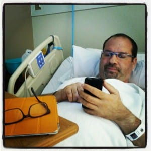 Photo of David Esrati in VA hospital bed recovering from kidney stone removal surgery