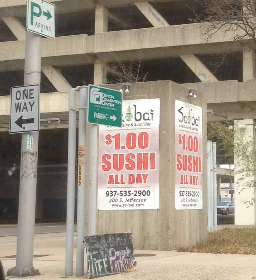 Sabai banner offering $1 sushi- a sure sign of impending closure