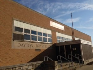 photo of Dayton Boys Club, East side, with banner of yet another charter school