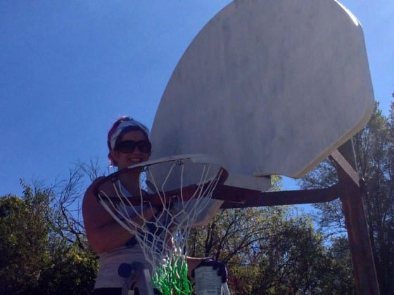Photo of Tabatha Muntzinger painting backboards