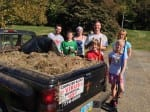 The bed of a pickup truck was filled with dirt and weeds from the court