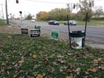 David Esrati puts out trash cans instead of yard signs