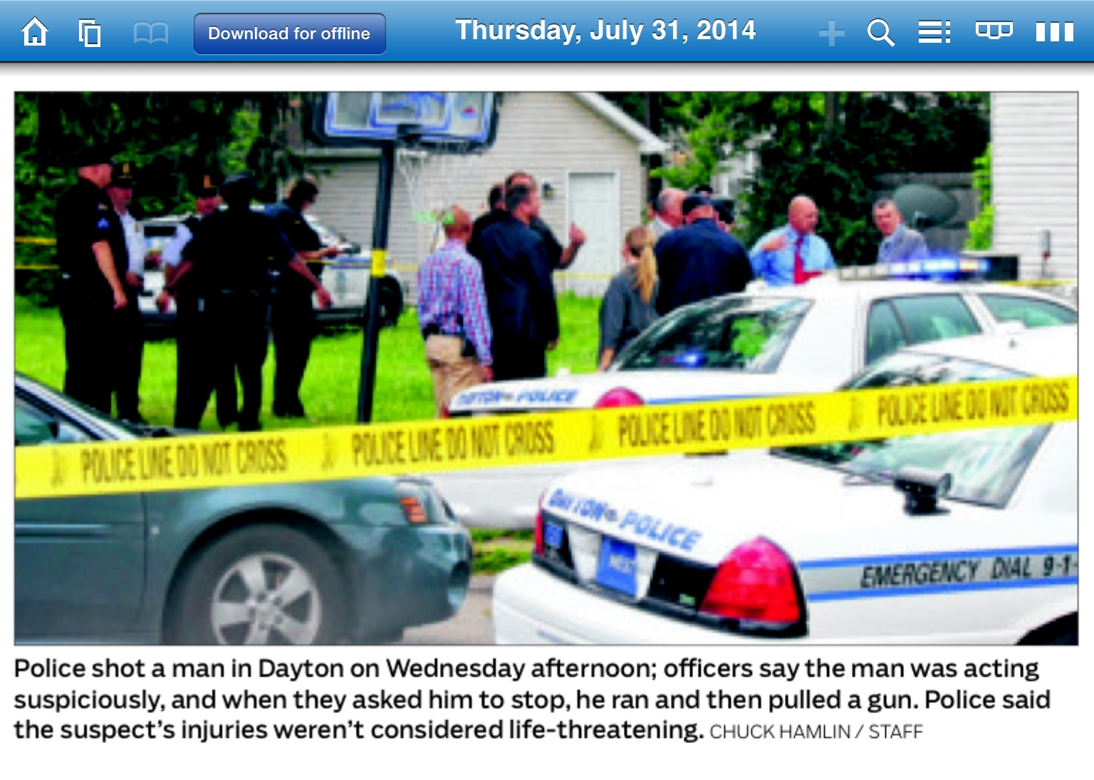 Crime scene photo in Dayton Daily news with Esrati net and sticker in background