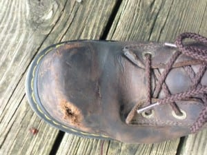 Photo of Doc Marten shoe after motorcycle accident. No damage to foot- just to the shoe