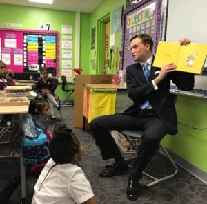 John McManus, reading to DPS kids. This is the only board member who gets it.