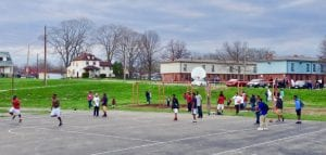 Kids playing basketball at DeSoto Bass basketball courts- with an Esrati supplied free green net